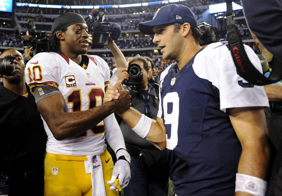 Washington Redskins quarterback Robert Griffin III (10) and Dallas Cowboys quarterback Tony Romo (9) greet each other after their NFL football game, Thursday, Nov. 22, 2012, in Arlington, Texas. The Redskins won 38-31. (AP Photo/Matt Strasen)