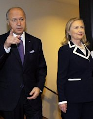 US Secretary of State Hillary Clinton and French Foreign Minister Laurent Fabius arrive for the &quot;Friends of the Syrian People&quot; conference in Paris. International leaders Friday urged the UN to ratchet up pressure on Syrian President Bashar al-Assad by threatening his regime with tough sanctions, as the defection of a top general rocked his inner circle