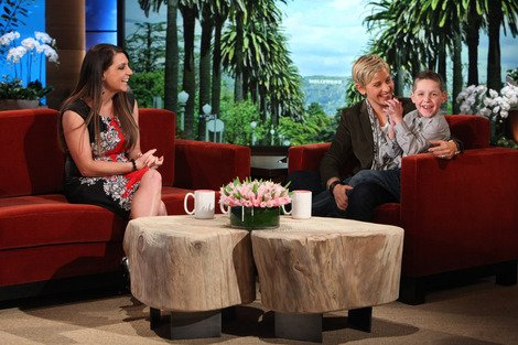 Tayt, 8, cuddles up next to Ellen.