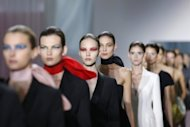 "Models present creations for Christian Dior's Spring/Summer 2013 ready-to-wear collection show in Paris. Dior's new designer Raf Simons offered up all the ingredients of the house's iconic silhouette, reworked for a ""sensual"" 21st century woman"