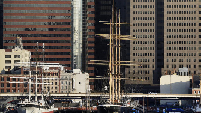 In this photo of April 13, 2013, historic sailing ships are docked at the South Street Seaport in New York. New York City has taken control of the financially-strapped waterfront museum, it was announced Monday, July 8, 2013. The museum is housed in a commercial building on Fulton Street that served the seaport starting in 1811. It also maintains the fleet of historic vessels. (AP Photo/Mark Lennihan)