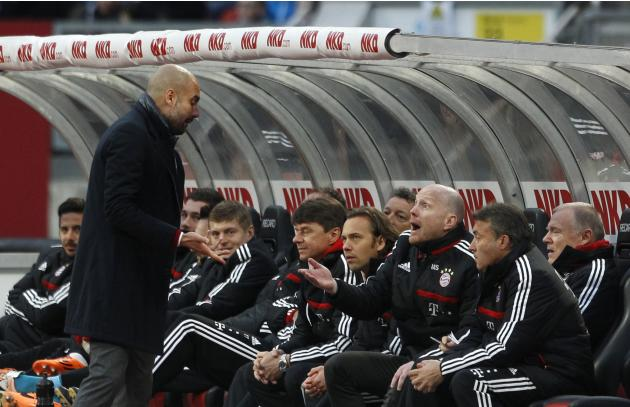 Bayern Munich's coach Guardiola talks to sport director Sammer during German Bundesliga soccer match against Nuremberg in Nuremberg