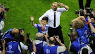 Chelsea interim manager Roberto Di Matteo (C) makes the victory sign after his side won the UEFA Champions League football final against Bayern Munich on May 19. Chelsea beat Bayern Munich 4-3 on penalties to win the Champions League