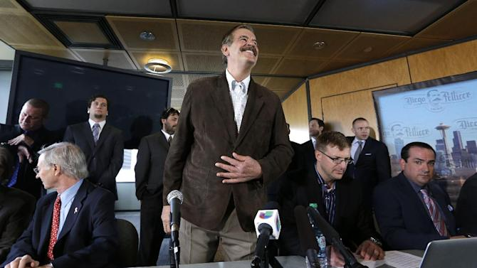 Former Mexican President Vicente Fox smiles as he prepares to take a seat for a news conference Thursday, May 30, 2013, in Seattle. Diego Pellicer Inc. announced recent acquisitions of medical marijuana dispensary chains in Washington and Colorado, creating the first national brand of retail cannabis. Diego also spoke about plans to expand across the United States and internationally, and to become the market leader in both medical and adult-use marijuana. (AP Photo/Elaine Thompson)