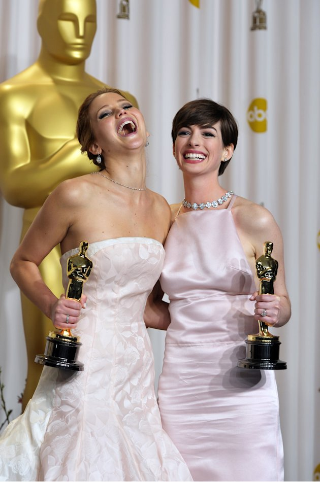 """Jennifer Lawrence with her award for best actress in a leading role for """"Silver Linings Playbook"""" and Anne Hathaway with her award for best actress in a supporting role for """"Les Miserables"""" pose durin"""