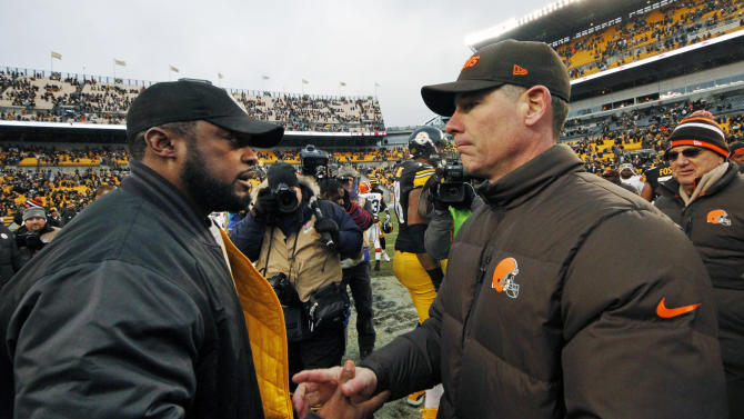 Pittsburgh Steelers head coach Mike Tomlin, left, shakes hands with Cleveland Browns head coach Pat Shurmur after the Steelers' 24-10 win in an NFL football game in Pittsburgh, Sunday, Dec. 30, 2012. (AP Photo/Gene J. Puskar)