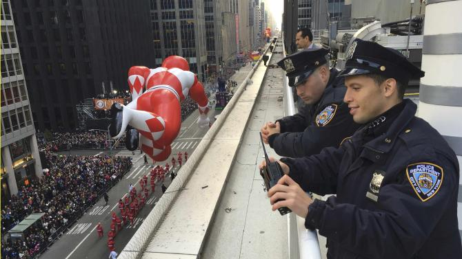 New York Police Department officers survey 6th Ave during the 89th Macy's Thanksgiving Day Parade in the Manhattan borough of New York