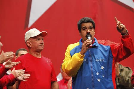 Venezuela's President Maduro speaks next to retired General Carvajal as they attends the Socialist party congress in Caracas
