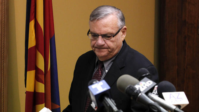 Maricopa County Sheriff Joe Arpaio, arrives to answer questions regarding the Department of Justice announcing a federal civil lawsuit against Sheriff Arpaio and his department, prior to a news conference Thursday, May 10, 2012, in Phoenix.  According to the Department of Justice, after months of negotiations failed to yield an agreement to settle allegations that the sheriff's department racially profiled Latinos in his trademark immigration patrols, the lawsuit was filed. (AP Photo/Ross D. Franklin, file)