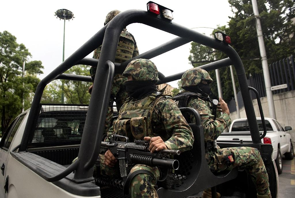 Mexico arrests nine cartel suspects after gunfight