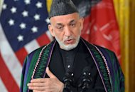 "Afghan President Hamid Karzai answers a question during a press conference at the White House on January 11, 2013. US President Barack Obama has said the US goal in Afghanistan is ""within reach"" as he vowed to move ahead with a timetable to end the 11-year-old military campaign and focus on a broad domestic agenda"