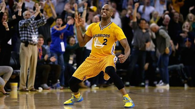 Jarrett Jack #2 of the Golden State Warriors celebrates after he made a three-point basket in the fourth period of their game against the San Antonio Spurs at Oracle Arena (AFP)