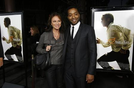 "Ejiofor poses with Bisset at a special screening of ""12 Years a Slave"" at the Directors Guild of America in Los Angeles"