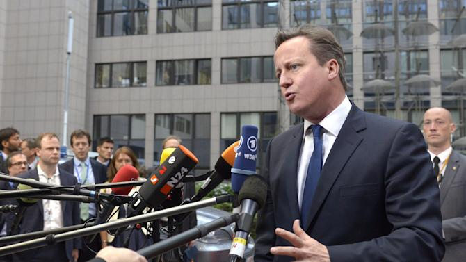 British Prime Minister David Cameron addresses the media upon arrival at the European Council building in Brussels, Tuesday, May 27, 2014. European Union leaders on Tuesday sought a way to bounce back from the weekend's landmark elections that saw a partly hostile and largely apathetic public question their project of closer cooperation as never before. (AP Photo/Eric Vidal)