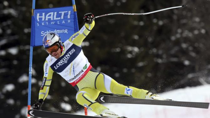 Norway's Aksel Lund Svindal speeds down the course during the downhill portion of the men's super-combined, at the Alpine skiing world championships in Schladming, Austria, Monday, Feb.11, 2013. (AP Photo/Luca Bruno)