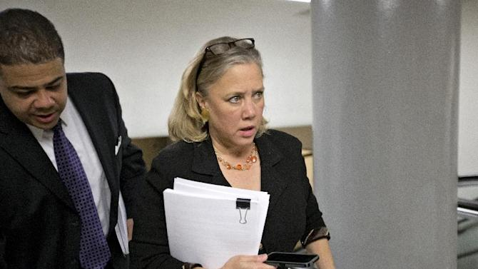 Sen. Mary Landrieu, D-La. rushes with other lawmakers to the Senate floor on Capitol Hill in Washington, Friday, March 22, 2013, to vote on amendments to the budget resolution. (AP Photo/J. Scott Applewhite)