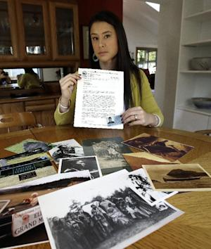 Mia Prickett sits at a table with a collection of familynbsphellip