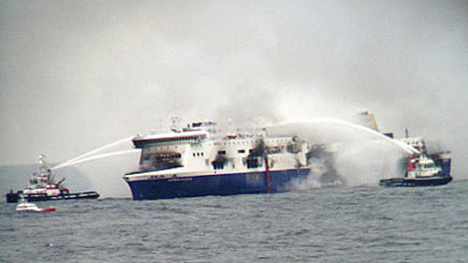 Fire fighting tug boats douche  the burning car Ferry Norman Atlantic