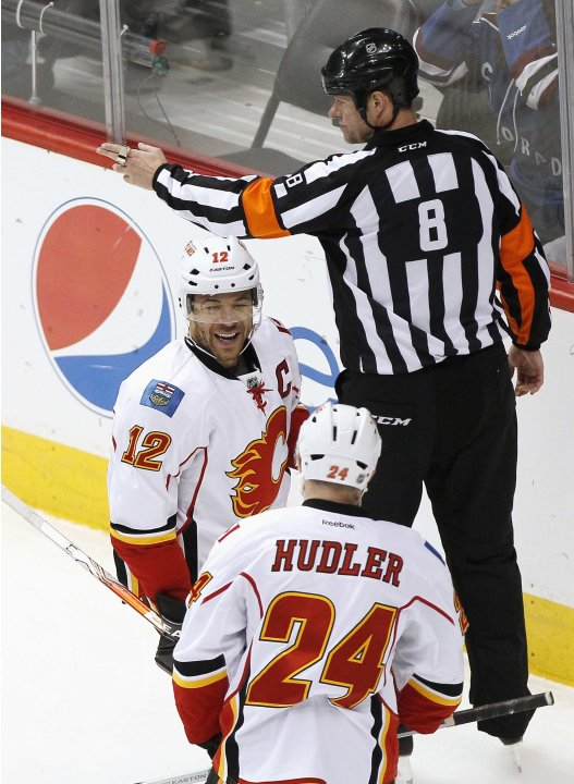 Calgary Flames' Iginla celebrates with teammate Hudler after scoring in the second period of their NHL hockey game against the Colorado Avalanche in Denver