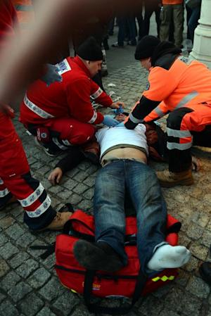 Emergency services take care of an injured demonstrator…