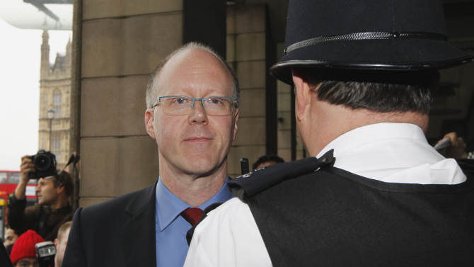 "FILE - A Tuesday, Oct. 23, 2012 photo from files showing BBC Director General, George Entwistle, leaving Portcullis House in London after giving evidence to the Parliament Select Committee. The BBC's director general said Saturday that it should not have aired a report that wrongly implicated a politician in a child sex-abuse scandal, admitting that the program further damaged trust in a broadcaster already reeling from the fallout over its decision not to air similar allegations against one of its star hosts. George Entwistle's comments followed an embarrassing retreat for the BBC, which apologized Friday for its Nov. 2 ""Newsnight"" TV show on alleged sex abuse in Wales in the 1970s and 1980s. During the program, victim Steve Messham claimed he had been abused by a senior Conservative Party figure. The BBC didn't name the alleged abuser, but online rumors focused on Alistair McAlpine, a Conservative Party member of the House of Lords. On Friday, he issued a fierce denial and threatened to sue. (AP Photo/Sang Tan, Flle)"
