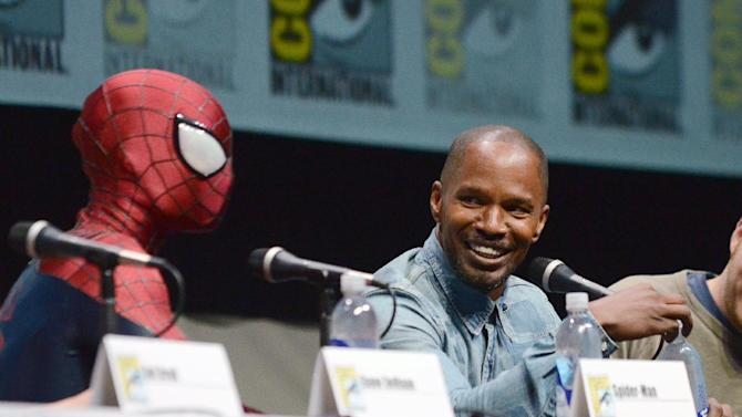 """Spider-Man, left, and Jamie Foxx attend the """"The Amazing Spider-Man 2"""" panel on Day 3 of Comic-Con International on Friday, July 19, 2103 in San Diego. (Photo by Jordan Strauss/Invision/AP)"""