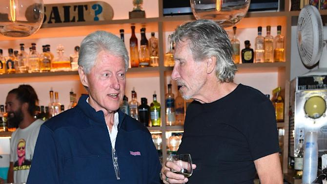 """EXCLUSIVE - Former U.S. President Bill Clinton, left, and musician Roger Waters attend the Hamptons Sneak Screening of Open Road Films' """"Rock the Kasbah"""" after party on Friday, Aug. 28, 2015 in East Hampton, N.Y. (Photo by Scott Roth/Invision for Open Road Films/AP Images)"""