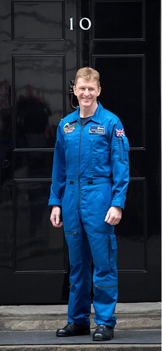 Former Apache helicopter pilot Tim Peake poses for photographers as he arrives at Number 10 Downing Street in London