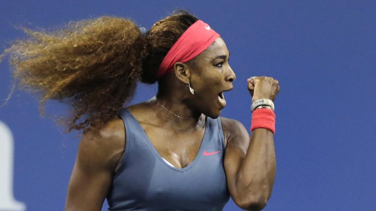 Serena Williams, of the United States, pumps her fist after winning a point against Francesca Schiavone, of Italy, during the first round of the 2013 U.S. Open tennis tournament, Monday, Aug. 26, 2013, in New York. (AP Photo/Charles Krupa)