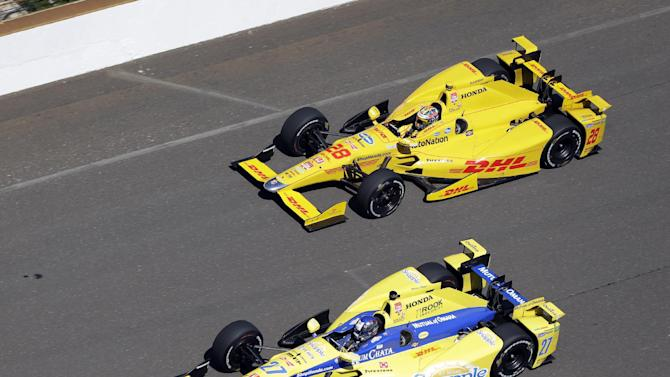 Marco Andretti (27) and Ryan Hunter-Reay  drive down the main straightaway during the final practice session for the Indianapolis 500 auto race at Indianapolis Motor Speedway in Indianapolis, Friday, May 22, 2015.  (AP Photo/Michael Conroy)