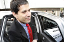 FILE - In this Monday, April 26, 2010 file photo, California-based electric-vehicle services provider Better Place Chief Executive Shai Agassi gets off an electric vehicle taxi during the opening ceremony of a battery switch station in Tokyo, Japan. (AP Photo/Shizuo Kambayashi, File)