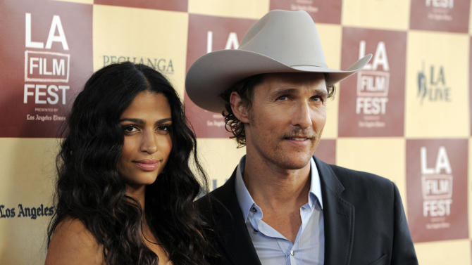 "Matthew McConaughey, a cast member in ""Bernie,"" poses with his wife Camila Alves at the premiere of the film on the opening night of the 2011 Los Angeles Film Festival, Thursday, June 16, 2011, in Los Angeles. (AP Photo/Chris Pizzello)"