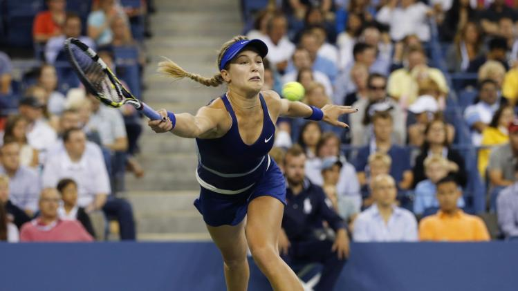 Eugenie Bouchard of Canada returns a shot to Barbora Zahlavova Strycova of the Czech Republic during their women's singles match at the 2014 U.S. Open tennis tournament in New York