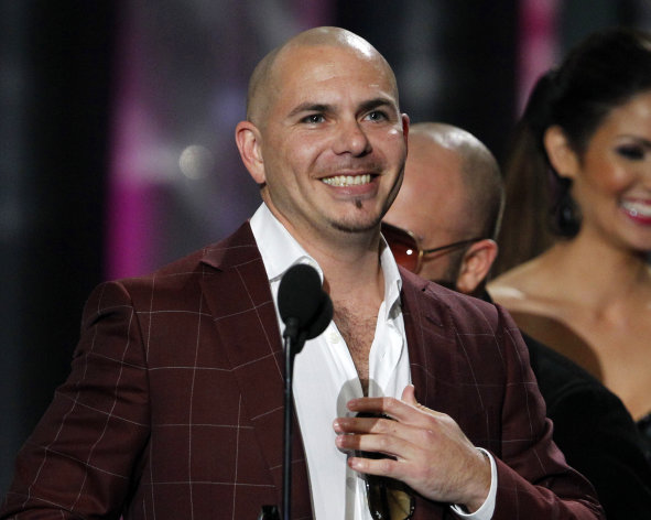 "FILE - This April 26, 2012 file photo shows rapper Pitbull smiling after accepting the award for the Song of the Year by a male performer during the Latin Billboard Awards in Coral Gables, Fla. KMXT reports that Walmart will send the Miami rapper, whose real name is Armando Christian Perez, to its store which gets the most ""likes"" on its Facebook page. A writer for the Boston Phoenix thought it'd be funny to send Pitbull to the most remote Walmart possible, and is encouraging people to ""like"" the Walmart in Kodiak. It seems to be working. The Kodiak Walmart had over 35,000 ""likes"" Monday, more than five times the town's population. Other Walmarts in Alaska lag with about 600 ""likes"" apiece. The promotion runs through the middle of the month. (AP Photo/Lynne Sladky, file)"