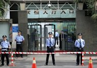 "Policemen stand guard outside the Chengdu People's Intermediate court in China's Sichuan province. China has put Wang Lijun -- an ex-police chief who triggered the Communist party's biggest scandal in years -- on ""public"" trial, with the court saying he did not contest the key charges against him"