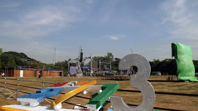 Workers set up a stage as preparations are underway for the country's first ever public New Year's countdown celebration, at Myoma grounds in Yangon, Myanmar, Monday, Dec. 31, 2012. (AP Photo/Khin Maung Win)