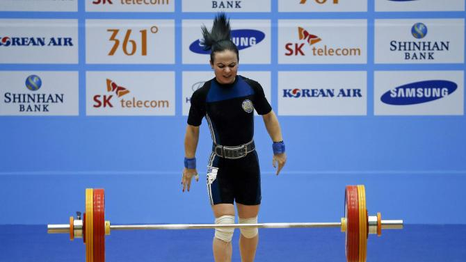 Kazakhstan's Margarita Yelisseyeva fails in her last attempt to lift 108kg in the women's 48kg clean and jerk weightlifting competition at the Moonlight Festival Garden during the 17th Asian Games in Incheon