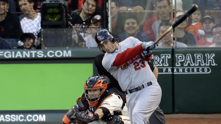 St. Louis Cardinals' David Freese hits a two-run home run during the second inning of Game 1 of baseball's National League championship series against the San Francisco Giants Sunday, Oct. 14, 2012, in San Francisco. (AP Photo/Mark Humphrey)