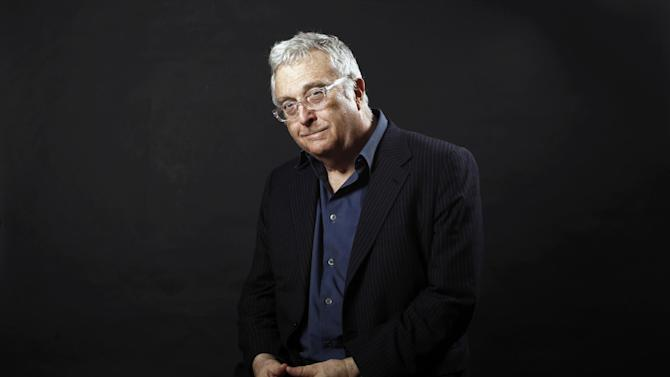 FILE - This Feb. 7, 2011 file photo shows musician Randy Newman posing after the Academy Award Nominees Luncheon in Beverly Hills, Calif. Newman is one of eight inductees to the Rock and Roll Hall of Fame, which also include rockers Heart and Rush, the late Donna Summer, rap group Public Enemy and bluesman Albert King, and Quincy Jones, this year's Ahmet Ertegun lifetime achievement honorees. (AP Photo/Matt Sayles, file)