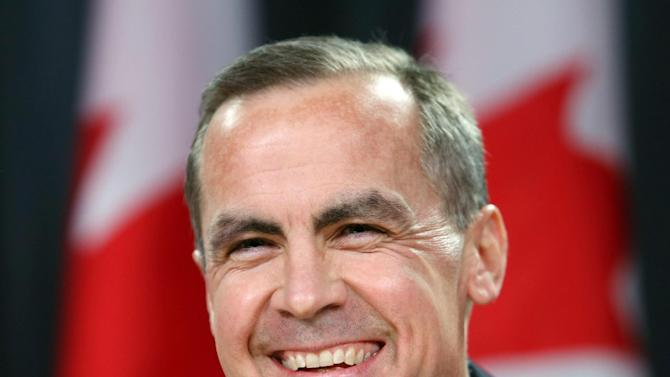 FILE - In this Monday, Nov. 26, 2012 file photo, Bank of Canada Governor Mark Carney, smiles at a news conference in Ottawa, Ontario. Carney, the former head of the Bank of Canada and the first non-Brit to run the 319-year-old Bank of England, moves into the bank's headquarters in the City of London on July 1. He faces a tough challenge: Helping rescue Britain's economy, which has been foundering since the onset of the 2008 economic crisis. While he won't do it alone, Britain's leaders are hoping he can inject confidence and try new ideas to revive the country's fortunes. (AP Photo/The Canadian Press, Fred Chartrand, File)