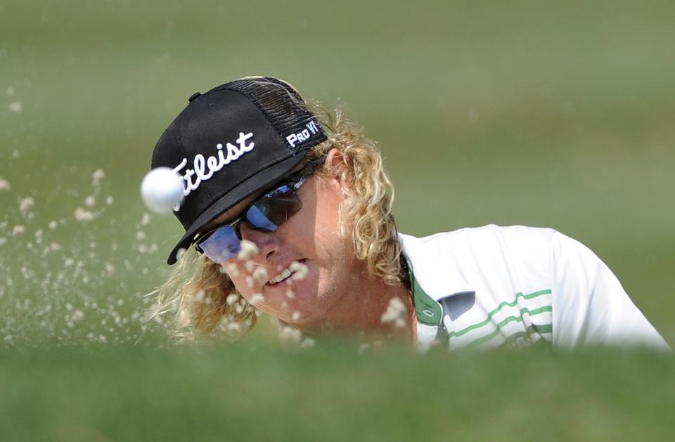 Charley Hoffman hits out of the bunker on the second green during the final round of the RBC Heritage golf tournament in Hilton Head Island, S.C., Sunday, April 21, 2013. (AP Photo/Stephen Morton)