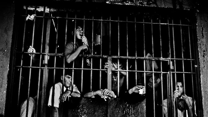 IMAGE DISTRIBUTED ON BEHALF OF THE SONY WORLD PHOTOGRAPHY AWARDS - Winner of the Professional Contemporary Issues category in the 2013 Sony World Photography Awards is Valerio Bispuri from Italy for his work documenting prisoners in Latin American jails. This photo shows inmates in prison in Santiago, Chile. (Valerio Bispuri/Echo Press/Sony World Photography Awards via AP Images)