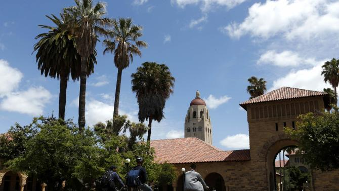 Cyclists traverse the Main Quad at Stanford University in Stanford