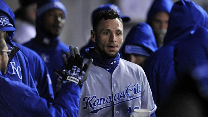 Kansas City Royals' Paulo Orlando celebrates with teammates in the dugout after scoring on a Alcides Escobar single during the third inning of a baseball game against the Chicago White Sox, Friday, April 24, 2015, in Chicago. (AP Photo/Paul Beaty)