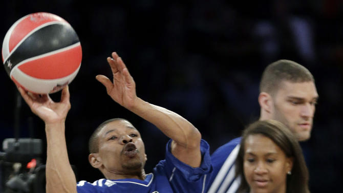 CORRECTS TO SHOOTING STARS CONTEST, NOT SKILLS CHALLENGE- Former NBA player Muggsy Bogues and Indiana Fever's Tamika Catchings participate in the shooting stars contest during NBA All-Star Saturday Night basketball in Houston on Saturday, Feb. 16, 2013. (AP Photo/Eric Gay)