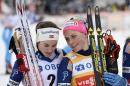 Norway's Therese Johaug, right, celebrates with second placed compatriot Heidi Weng after winning the women's 10 km competition at the FIS Cross-Country World Cup in Falun, Sweden, Sunday Feb. 14, 2016. (Maja Suslin/TT via AP) SWEDEN OUT