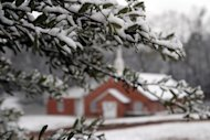 Snow lightly blankets a small tree near the New Era Baptist Church in Meridian, Miss., Thursday, Jan. 17, 2013. The early morning snow didn&#39;t last long as it was all gone before noon. (AP Photo/The Meridian Star, Paula Merritt)