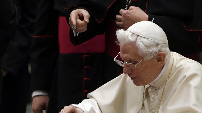 """Pope Benedict XVI pushes a button on a tablet at the Vatican, Wednesday, Dec. 12, 2012. Pope Benedict XVI hit the 1 million Twitter follower mark on Wednesday as he sent his first tweet from his new account, blessing his online fans and urging them to listen to Christ. In perhaps the most drawn out Twitter launch ever, the 85-year-old Benedict pushed the button on a tablet brought to him at the end of his general audience after the equivalent of a papal drum roll by an announcer who intoned: """"And now the pope will tweet!"""" """"Dear friends, I am pleased to get in touch with you through Twitter. Thank you for your generous response. I bless all of you from my heart,"""" the inaugural tweet read. (AP Photo/Gregorio Borgia)"""