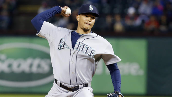 Seattle Mariners starting pitcher Taijuan Walker (32) throws during the first inning of a baseball game against the Texas Rangers, Monday, April 27, 2015, in Arlington, Texas. (AP Photo/Brandon Wade)