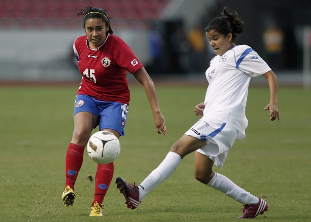 Costa Rica's Granados battles for ball with Nicaragua's Lopez during women's final soccer match at Central American Games in San Jose